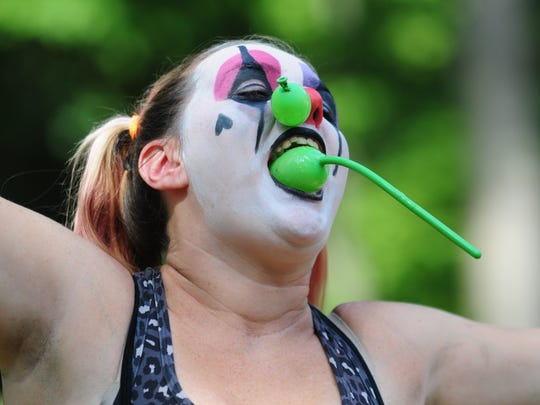 """Cheeks"" of Circus Rejects in Columbus, New Jersey, performing her balloon stunt."