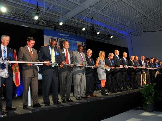 Embraer held a ribbon cutting Monday morning for its new 50,000 square foot manufacturing facility Embraer Aero Seating Technologies in Titusville.