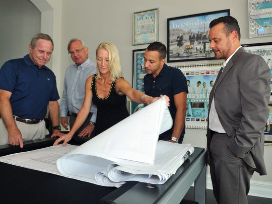 Howie Dorough and others gather to look over the blueprints