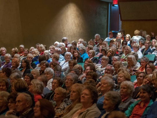 People fill their seats Monday, Oct. 3, during the Town Hall lecture series at McMorran Theater.