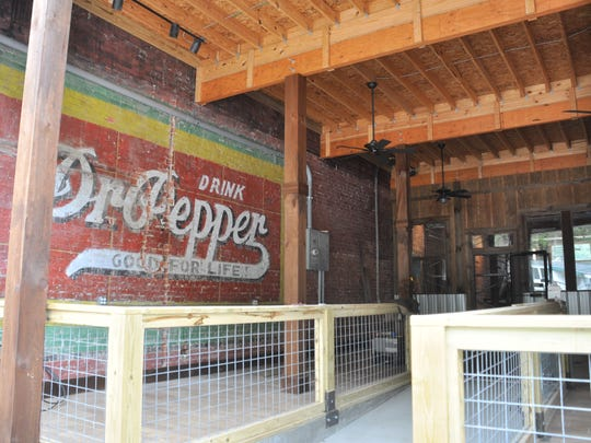 Work by builders Every Angle and NGH exposed a ghost wall ad for Dr. Pepper along Madison County Brewing Company's front deck.