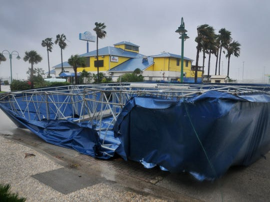 The awning for Fishlips Bar & Grill blows off during Hurricane Matthew in 2016. The storm packed 120 mph winds.