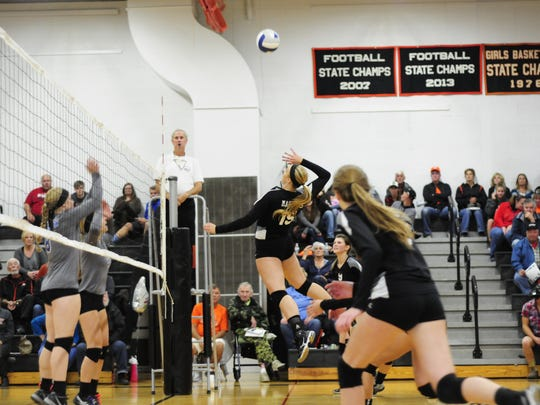 Marine City's Paige Tranchida spikes the ball against Lakeview on Oct. 13, 2016.