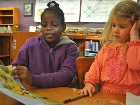 Thurston Woods Campus student Tameka reads to 3-year-old