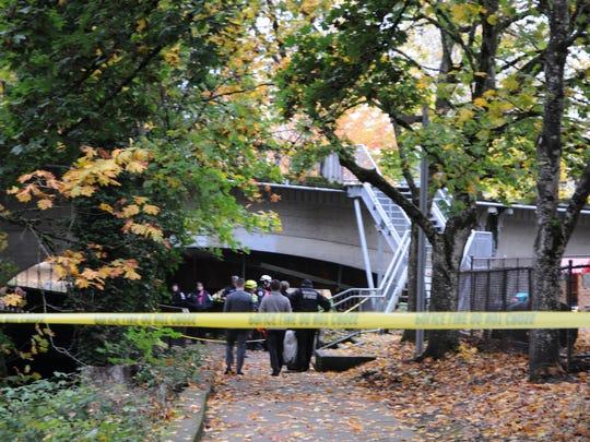 Salem police investigate a body found in Pringle Creek Monday morning.