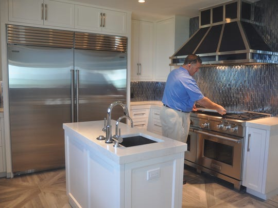 Realtor Bill Leach shows off the butler's kitchen.