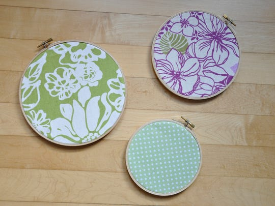 Use leftover fabric to create embroidery hoop art.