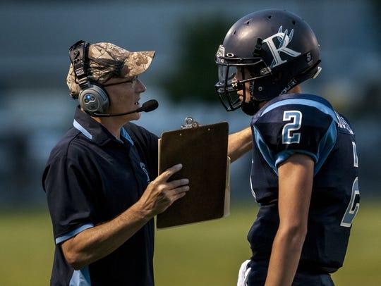 Richmond coach John Kocher talks with Chase Churchill