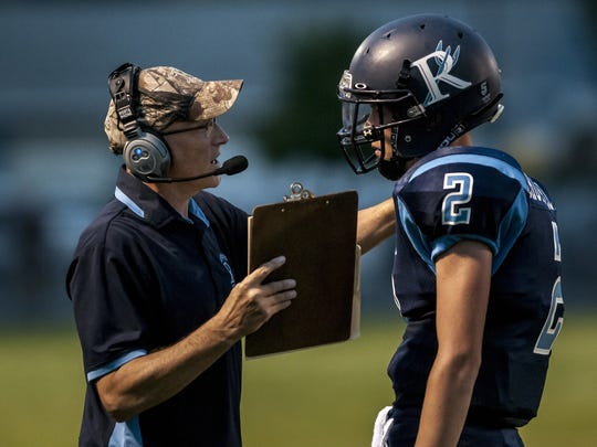 Richmond coach John Kocher talks with Chase Churchill during a football game  Sept. 9  at Richmond High School. Richmond coach John Kocher talks with Chase Churchill between plays during a football game Friday, September 9, 2016 at Richmond High School.