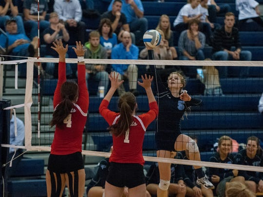 Blue Devils' Amanda Gorr hits the ball over the net