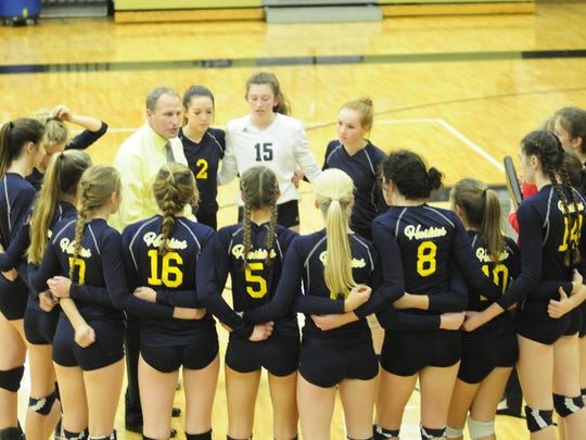 Port Huron Northern huddles during the first set against