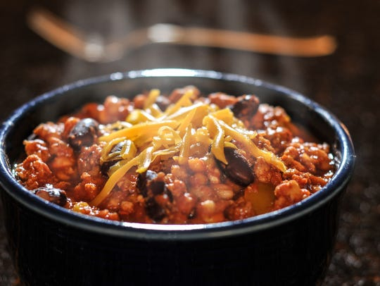 A steamy bowl of Chili topped with chedder cheese