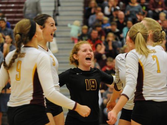 Harrisburg Tiger Rachel Nelson (19) celebrates a set
