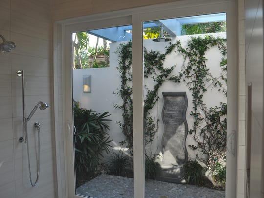 The master bathroom shower leads to a small courtyard with an outdoor shower.