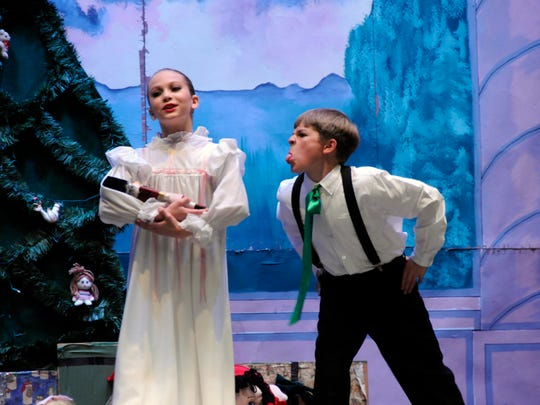 "Haley Davis as Clara and Todd Lani as Fritz in a performance of SNB's ""Peanutcracker: The Story in a Nutshell."""