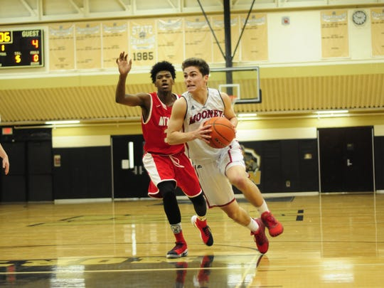 Cardinal Mooney junior Daniel Everhart drives to the basket against Mount Clemens in the Dave Jackson Tip-off Classic on Dec. 10, 2016.
