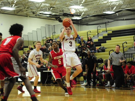 Cardinal Mooney junior Daniel Everhart shoots against Mount Clemens in the Dave Jackson Tip-off Classic on Dec. 10, 2016.