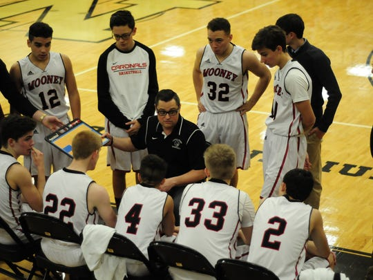 Cardinal Mooney head coach Mike McAndrews talks to his team before the second half against Mount Clemens  in the Dave Jackson Tip-off Classic on Dec. 10, 2016.