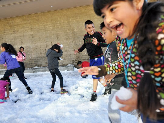 Winter fun at the César Chávez Library's fourth annual Snow Day in east Salinas.