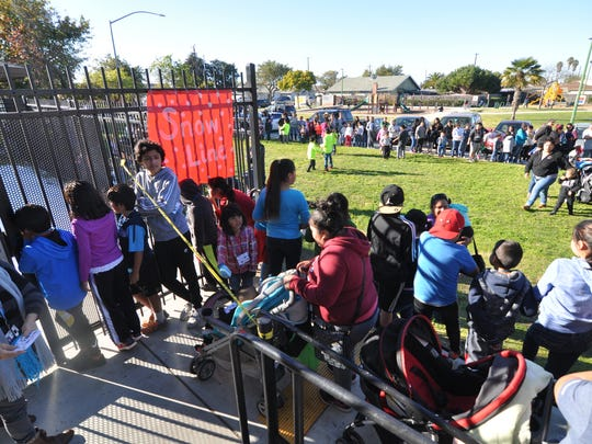 Hundreds of children got a chance to enjoy winter at the César Chávez Library's fourth annual Snow Day in east Salinas.