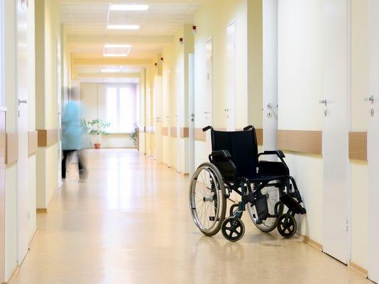 Wheel chair at the hospital corridor.