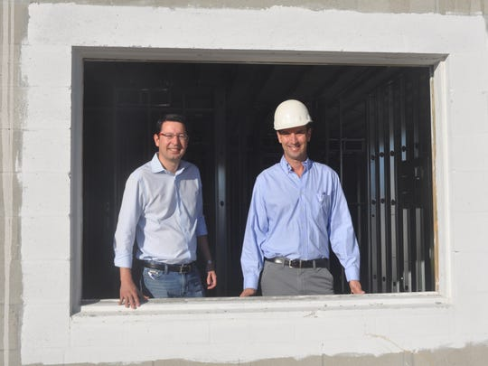 David Torres and Gary Hains of FL Star oversee the new apartment complex they are building in Naples.