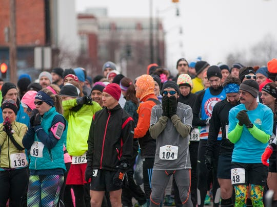 Runners prepare for the 10 mile run Sunday, Jan. 29, during the PoHo Hot Cocoa Run in Port Huron.