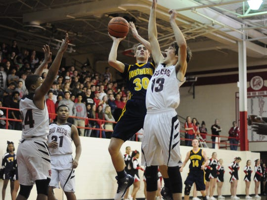 Port Huron Northern's Dane Vos goes for a layup against