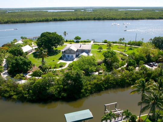 This is an aerial photo of the Mound House on Fort Myers Beach. The house, now a museum, sits on top of a 2,000-year-old Calusa Indian Shell Mound.