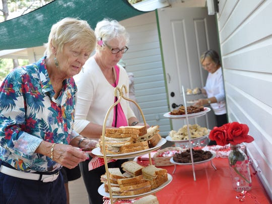 Eileen Lutz samples refreshments during the Valentine's Tea at the Estero Historical Society cottage Feb. 13.