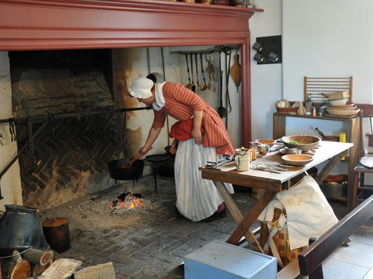 Colonial re-enactors periodically cook over the hearth at the restored Griffith Morgan House in Pennsauken along the Delaware River. The house dates before Pennsauken's  incorporation in 1892.