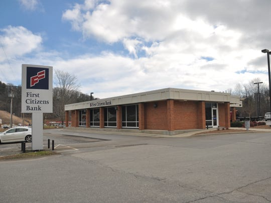 An armed male suspect fired a shot inside the First Citizens Bank on U.S. 25-70 March 1. Law enforcement captured two suspects minutes later on North Main Street in Marshall.
