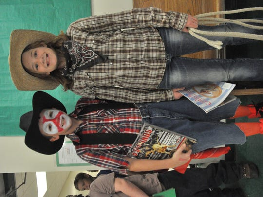 """Cousins Noah Marler and McKenzie Price dressed as a clown and rider from rodeo-based books for the parade. """"It's a family tradition,"""" Marler said to explain why they chose their creative costumes."""