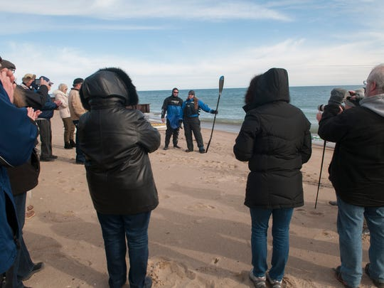 Traci Lynn Martin and Chris Stafford says a few words Thursday, March 9 at Lighthouse Beach in Port Huron before Traci starts her trip around the Great Lakes in 265 days.