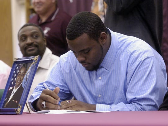 2-7-07, online  National Signing Day (18 of 24)  Pensacola High School senior Terrell McClain left, signs a letter of intent with the University of South Florida in the symbolic presence of his mother Lynn McClain, who is out of the country. McClain and 7 other current and former teammates sign letter of intent to play football in college.  Tony Giberson/tgiberson@pnj.com
