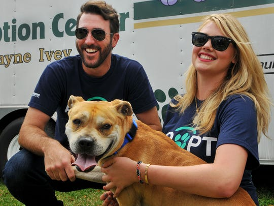 Cy Young Award-winning pitcher Justin Verlander and future fiancee Kate Upton pose with a dog during their 2015 Grand Slam Adoption Event outside Space Coast Stadium in Viera.