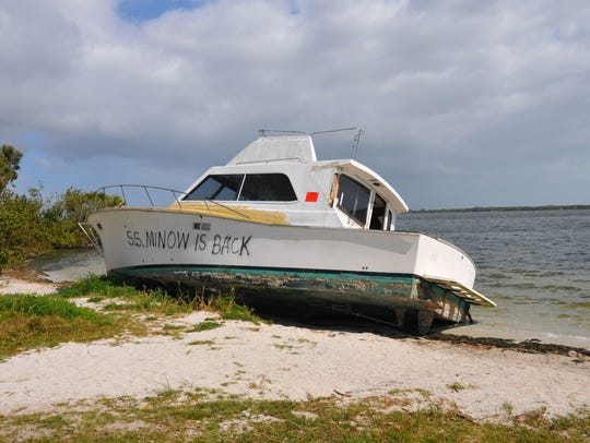 Just north of Pineda Causeway, a cabin cruiser named