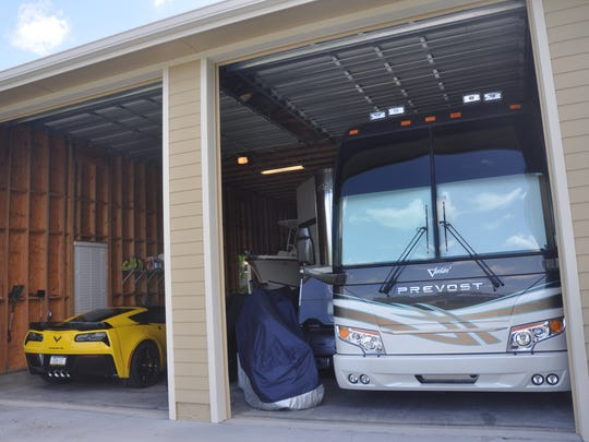 Ralph and Pam Greco manage to squeeze a motor home, motor home trailer, boat, cars, motorcycles, a golf cart and more into their man cave at Horse Creek.