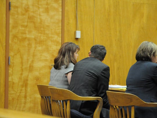 Kimberly Malm, speaks with her attorney Jason Thompson at her sentencing Wednesday. Malm, 37, of Salem, was sentenced to three years probation for a 2015 fatal hit-and-run crash.
