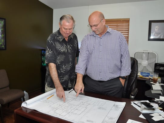 Estero United Methodist Church Building Committee Chair Jim Burg and Pastor Tim Carson look over plans for the layout of the church's expansion, scheduled for completion in January 2018.