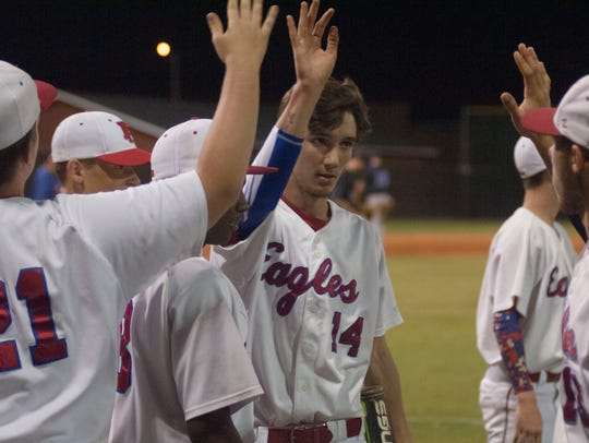 Pine Forest players celebrate after scoring a run in