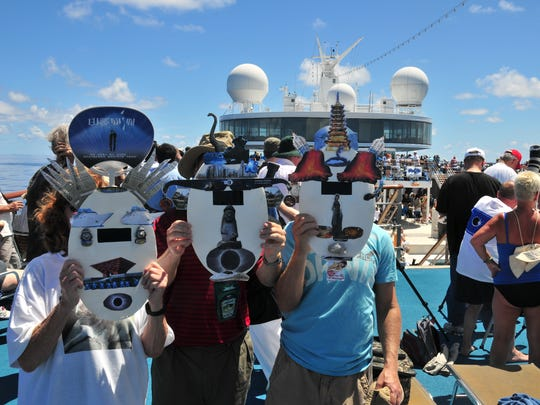 These three unidentified people constructed fanciful eclipse masks with eclipse filters to view the 2009 total solar eclipse aboard the cruise ship Costa Classica in the West Pacific Ocean near Iwo Jima.