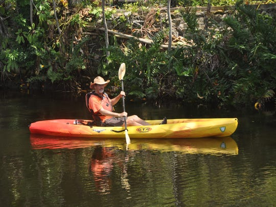 Aaron Thomas, one of the owners of CGT Kayak in Bonita Springs, is an instructors of the paddle craft safety class on Saturday in Naples.