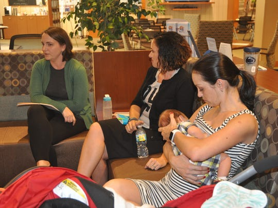 Leticia Englehart nurses her son Rafael, two months, during the Fourth Trimester Club while Shannon Wiseley and Julia Thompson, both MSW (Masters Social Work) Registered Interns, lead the discussion.
