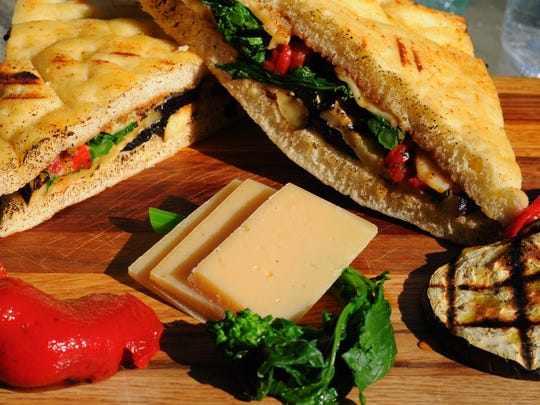 Marinated and roasted eggplant, broccoli rabe, and roasted red pepper with fresh mozzarella cheese and garlic crema on focaccia bread make up the Melanzana by Rob's Craft Sandwiches.