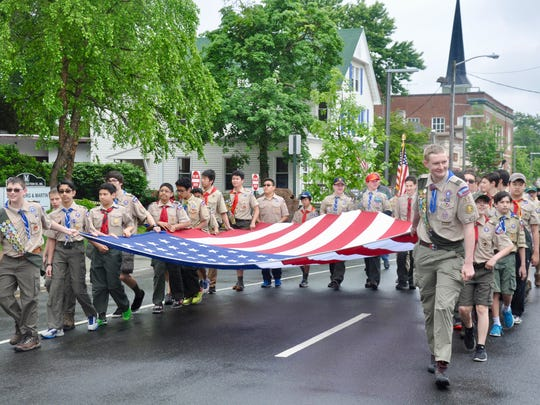 Boy Scouts of Troop 17, St. Rose of Lima Church march in the Memorial Day parade.