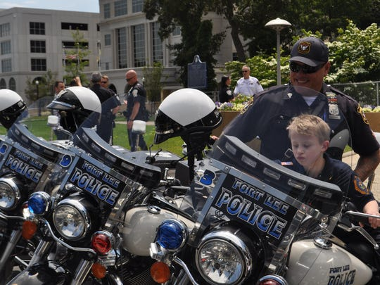 James Hahn, 9, of Oradell checks out Fort Lee police motorcycles and mingles with the men and women in blue.