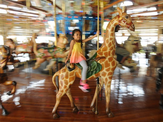 Taking a ride at Richland Carrousel Park is just one