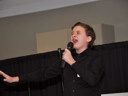 """Michael Cherbini, 13, sings """"One Last Prayer"""" during the Miromar Has Talent Finals June 24. He took first place in the 13 & Under age group."""