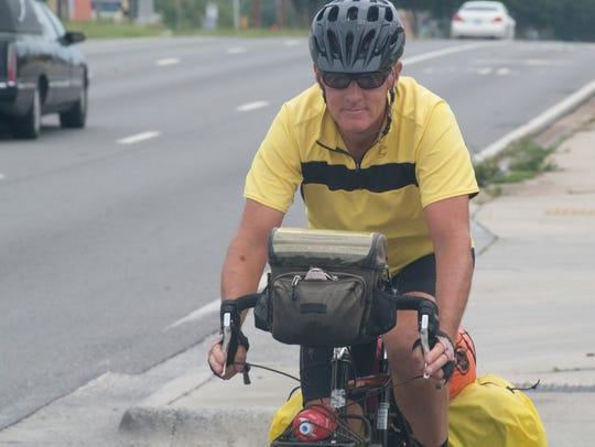 U.S. Army veteran Robert Neidlinger cycles through